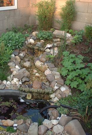 waterval aanleggen bij een bestaande vijver groeninfo